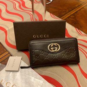 Authentic Gucci GG Guccissima Zip Around Wallet.
